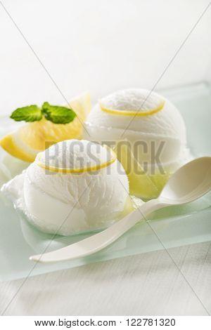 Fresh fruit sorbet ice cream in a white bowl.