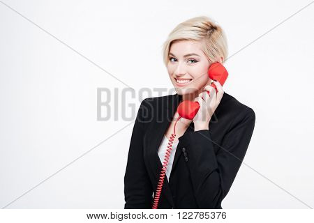 Smiling businesswoman talking on the phone tube isolated on a white background