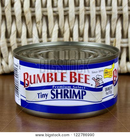 RIVER FALLS,WISCONSIN-MARCH 22,2016: A can of Bumble Bee brand tiny shrimp. Bumble Bee Seafoods was founded in Eighteen Ninety Nine.