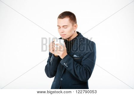 Businessman holding cup with tea isolated on aw hite background