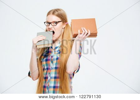 Female student biting book isolated on a white background