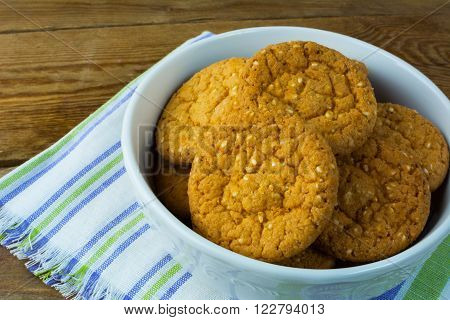 Sesame cookies on rustic wooden background close up. Breakfast cookie. Dessert cookies. Cookies. Breakfast. Sweet cookie. Homemade cookies.