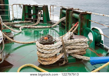 Ship ropes folded on a ship in straps