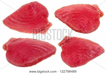 four slices of raw tuna fish meat isolated on white background