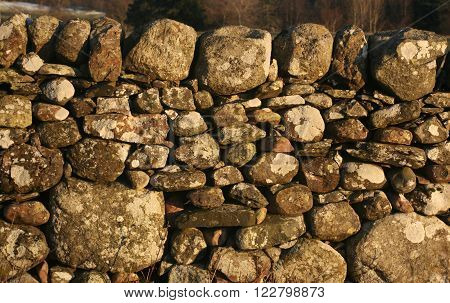 Traditional dry stone wall in winter light