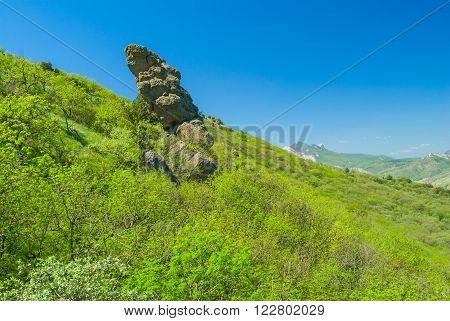 Disorderly lying rocks on slopes of ancient volcanic mountain range Kara Dag Eastern Crimea