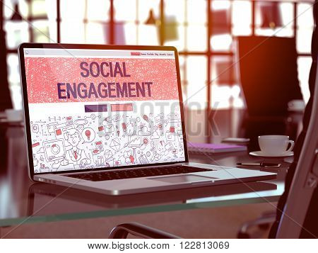 Modern Workplace with Laptop Showing Landing Page in Doodle Design Style with Text Social Engagement. Toned Image with Selective Focus. 3D Render.