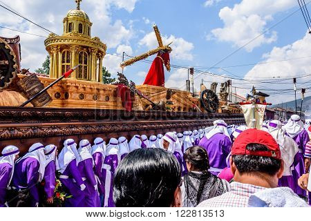 Antigua Guatemala - March 20 2016: Float bearers carry float with Jesus in Palm Sunday procession in colonial town with most famous Holy Week celebrations in Latin America.