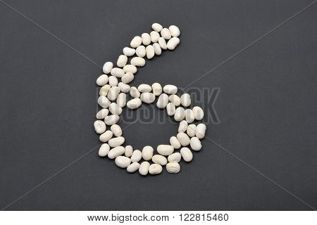 Number Six Made From White Beans On Black Background. Food Vegan, Vegetarian. Healthy Food