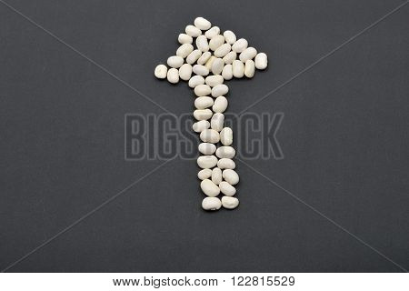 Arrow Made From White Beans, Pointing The Way On Black Background. Food Vegan, Vegetarian. Healthy F