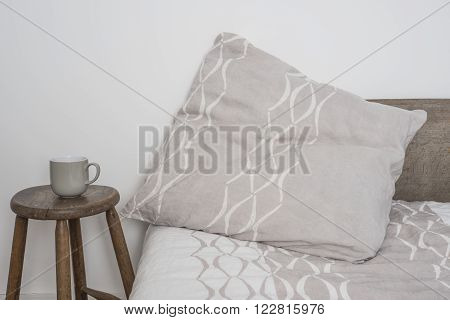 Gray Throw Pillow With White Concave Line On Bed
