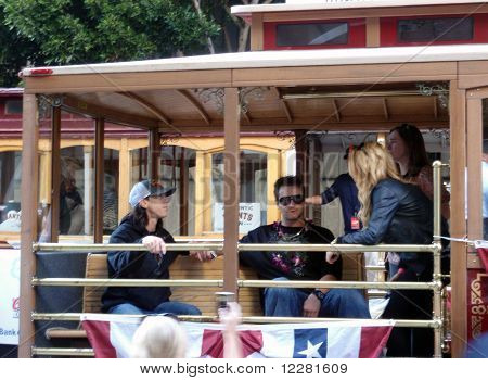 Giants Tim Lincecum Wears A Red Bull Hat And Dan Runzler Sit On Trolley Alisten To Girl Talk