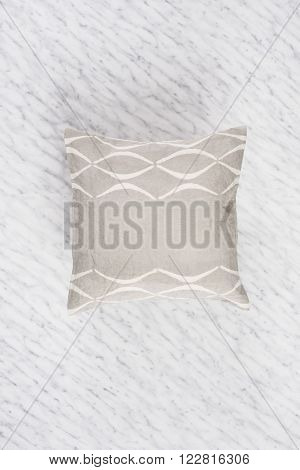 Square Gray Throw Pillow On Marble