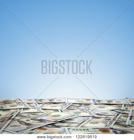 big pile of money. stack of american dollars on the sky background