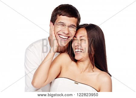 Portrait of young lovely interracial couple, hispanic man and asian girl, hugging and laughing out loud isolated on white background - laughter concept