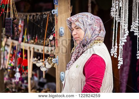 Mature Woman Selling Trinkets In Assos Turkey