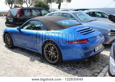 Saint-Paul-de-Vence France - March 22 2016: Blue Porsche 911 Carrera S Cabriolet Parked in a Parking Lot in Saint-Paul-de-Vence Southeastern France