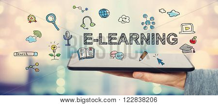 E-learning Concept With Man Holding A Tablet