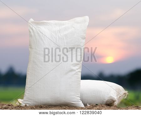 Agriculture, Fertilizer bag in moring time over sunrise background