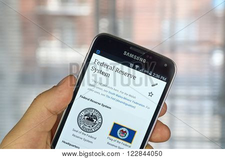 MONTREAL CANADA - MARCH 20 2016 - Federal reserve system logo and site on Samsung S5's screen. Fed is the central banking system of the United States.