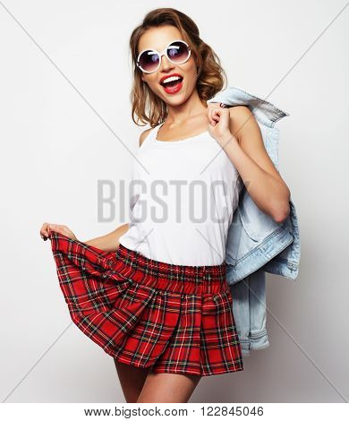 Lovely student girl wearing short skirt. On white background.