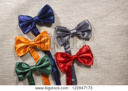 Set the bow tie in different colors for the celebration on a gray background