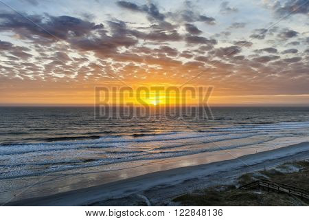 Sunrise over Atlantic ocean with dramatic sky in Florida, aerial view.