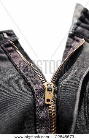 Close-up zipper of old black jeans, selective focus
