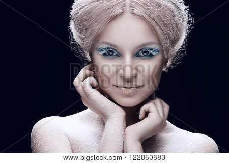 Beautiful young female face with bright fashion snow make-up
