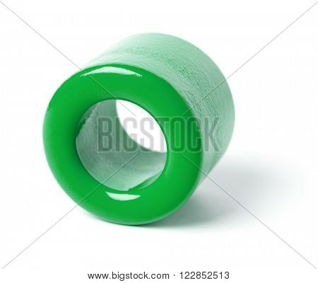 Green ferrite toroidal core isolated on white background.