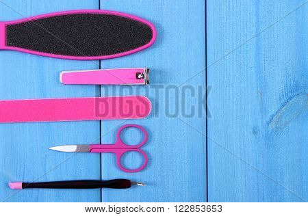 Accessories for manicure or pedicure, nail file, scraper, scissors, nail clippers, concept of nail, hand and foot care, copy space for text or inscription