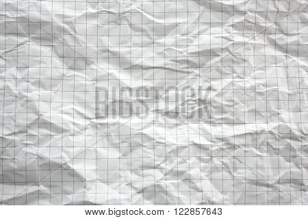 Blank crumpled graph paper background.