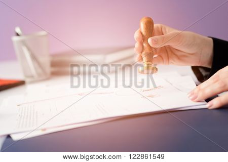Notary Public notarizes the contract in office