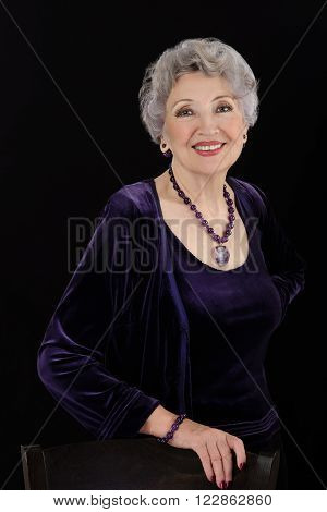 Portrait spectacular older woman with amethyst jewelry
