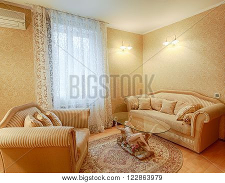 Vintage classic hotel room interior. Luxurious hotel suite premium interior design. Vintage bedroom, elegant and luxurious. Hotel classic interior. Sofa, table, double bed with canopy.