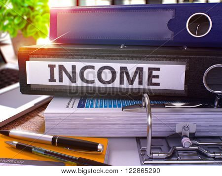 Black Ring Binder with Inscription Income on Background of Working Table with Office Supplies and Laptop. Income - Toned Illustration. Income Business Concept on Blurred Background. 3D Render.