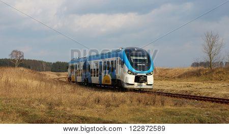 SLUTOWO, POLAND - March 19. 2016: The local train no. SA139-001 from Pila to Szczecin in Poland.