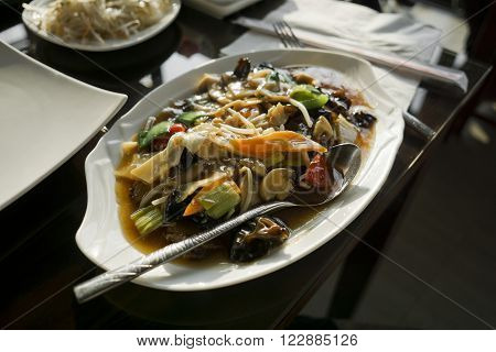 Chinese food - stir fry mixed vegetables with sauce.