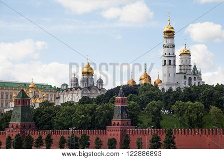 MOSCOW RUSSIA JUNE 12 2013: View to Kremlin Wall Ivan the Great Bell Tower Cathedrals of Moscow Kremlin.