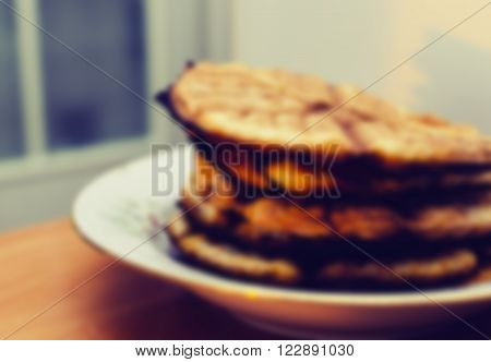 Abstract blurred defocused effect on the home plate with cookies