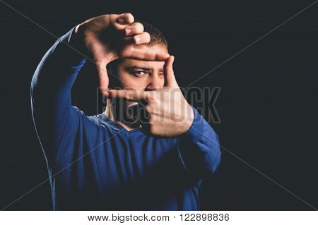 Young man making a frame with his hands