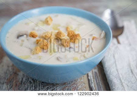 Creamy Mushroom Soup on a wooden background