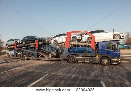 FRANKFURT GERMANY - MAR 14: Car transporter truck with new Mercedes Benz cars. March 14 2016 in Frankfurt Main Germany