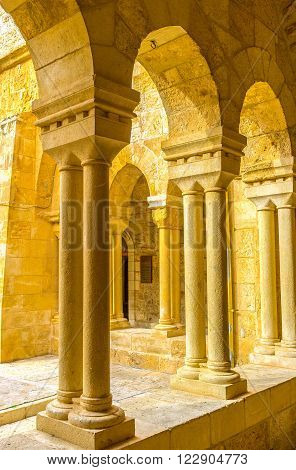 BETHLEHEM PALESTINE - FEBRUARY 18 2016: The columns of the covered gallery next to the inner courtyard of the Church of the Nativity on February 18 in Bethlehem.