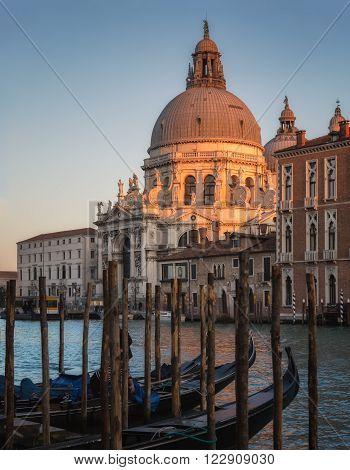 Gondolas And Basilica Di Santa Maria Della Salute In Venice