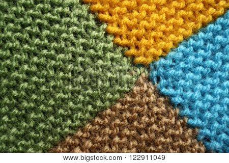 Knitted blanket macro. Four squares in different colors