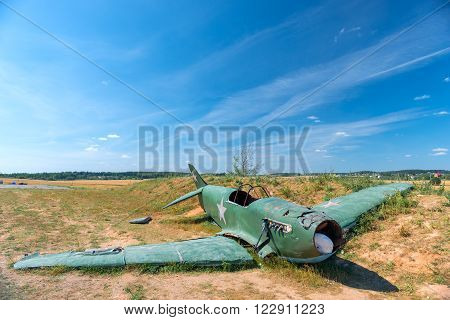 The Remains Of The Crashed Military Aircraft In The Field