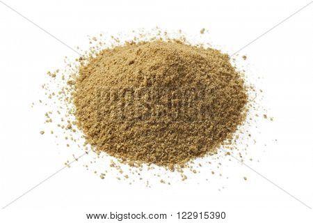 Heap of ground cumin seeds on white background