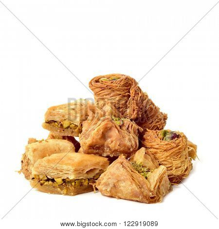 closeup of some different baklava pastries on a white background