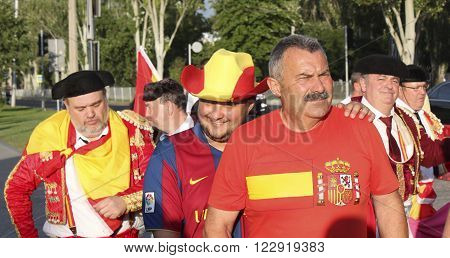 DONETSK UKRAINE - JUNE 27 2012: Unidentified Spanish soccer fans before UEFA EURO 2012 match in Donetsk near Donbass Arena